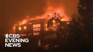 Southern California fire burns mobile homes, Malibu mansions