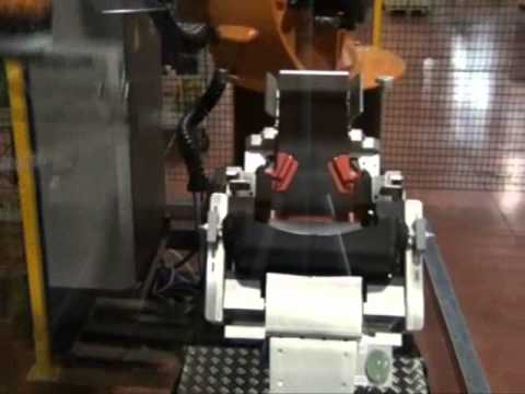 Automatic assembly of plastic baby-seats with anthropomorphic robot.wmv