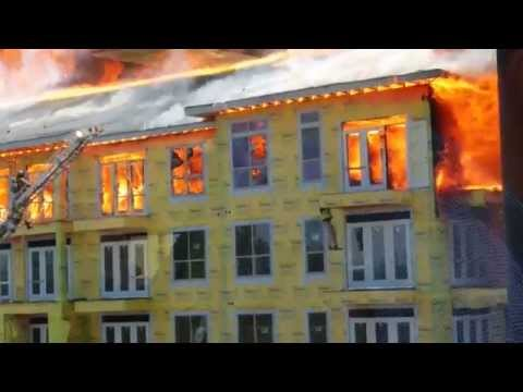 Construction worker rescued from massive apartment fire