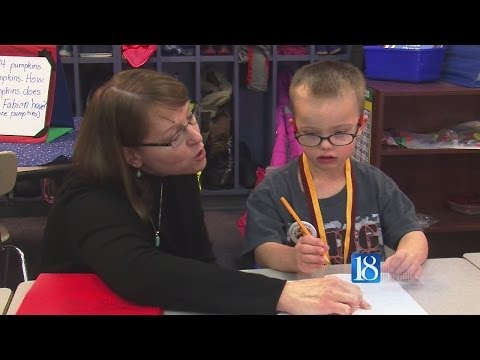 Down syndrome boy saves student