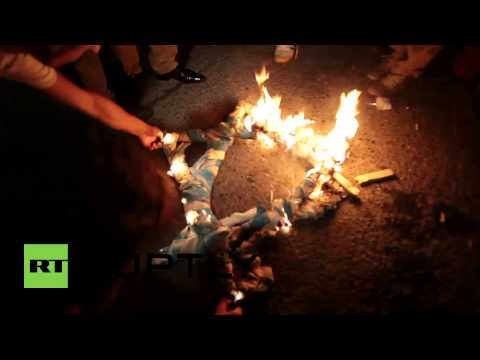 Turkey: Protesters burn Israeli flag over Gaza military offensive