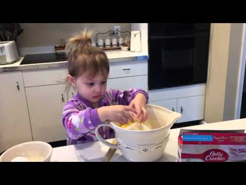 2 year old Leah baking a cake