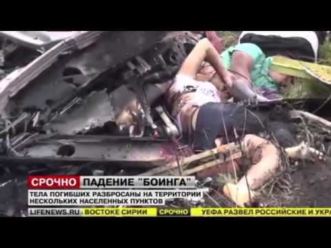 Malaysian flight MH17 CRASH SITE DEAD BODY'S AND PASPORTS LIVE NEWS