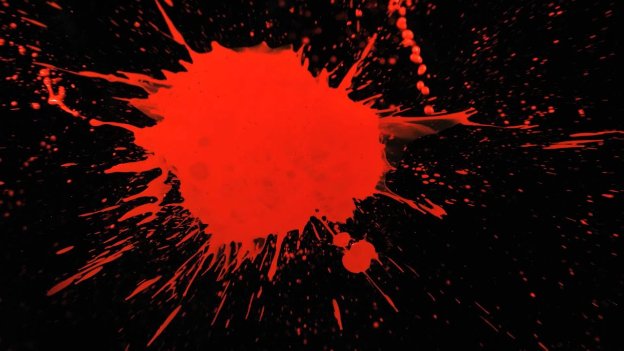 Slow Motion Paint Splatter With Red Paint Splattering A