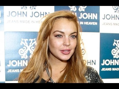 Lindsay Lohan defended in Hilton row (Photos)