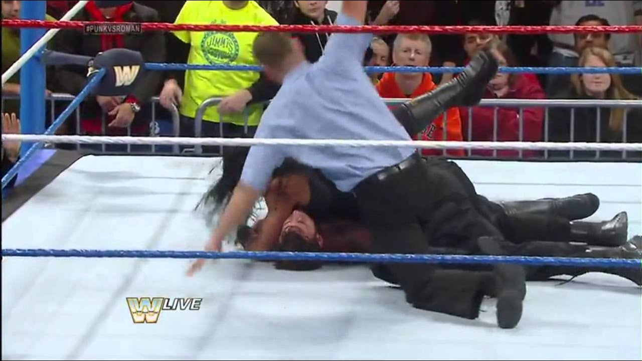 Roman Reigns SuperMan Punch In Mid-Air To CM Punk - YouTube