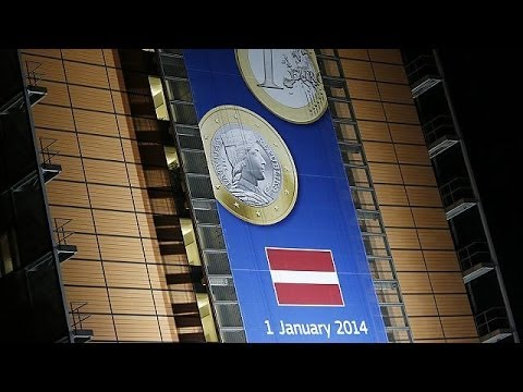 Latvians bank on new euro membership to continue recovery