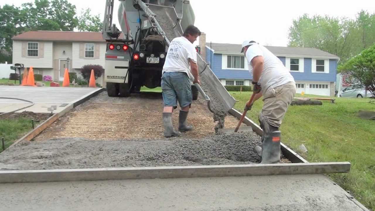How to pour a concrete driveway youtube for Pouring concrete driveway