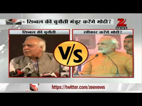 Law Minister Kapil Sibal challenges Narendra Modi to a public debate