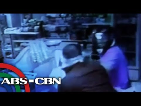 Customer fights robber
