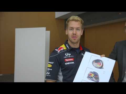 Sebastian Vettel congratulates the winner of the Abu Dhabi Helmet Design Competition