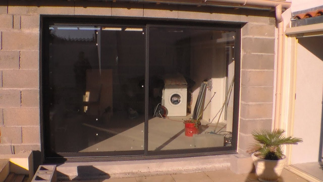 Comment poser une baie vitr e how to put a bay window for Monter porte de garage