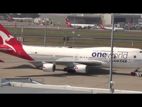 Qantas Airlines 'One World' B747 push-back, startup, taxi & takeoff Sydney Airport