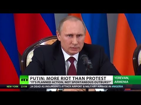 Putin: Ukraine unrest looks like planned action, not revolution