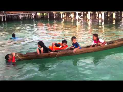 Great Life skill for us to learn= Bajau Laut girl teaches us how to save  a flooded canoe