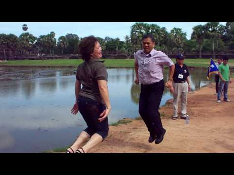 tourists having crazy photos in front of Angkor Wat Cambodia