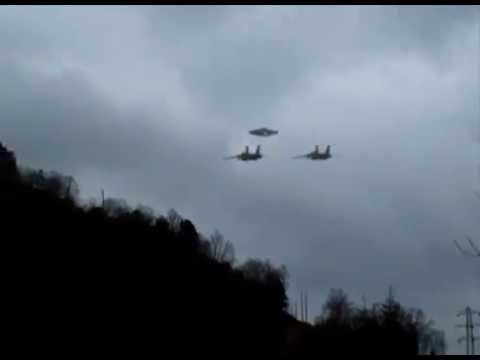 Two Jet Fighters escorting UFO