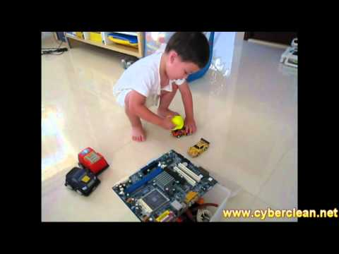 A kid cleaning his toys using Cyber Clean!