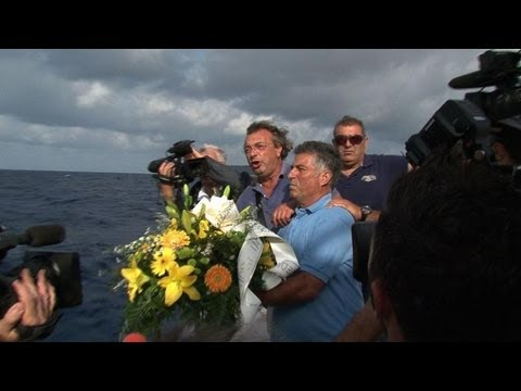 Flowers laid at sea in memory of Italy shipwreck dead