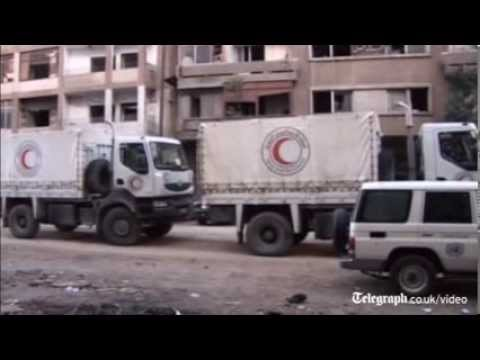 Syria: Mortar fire halts Hom aid efforts