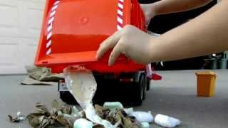 Recycle Kid plays with his Bruder MAN TGA Rar loading garbage truck; it's awesome! view on youtube.com tube online.