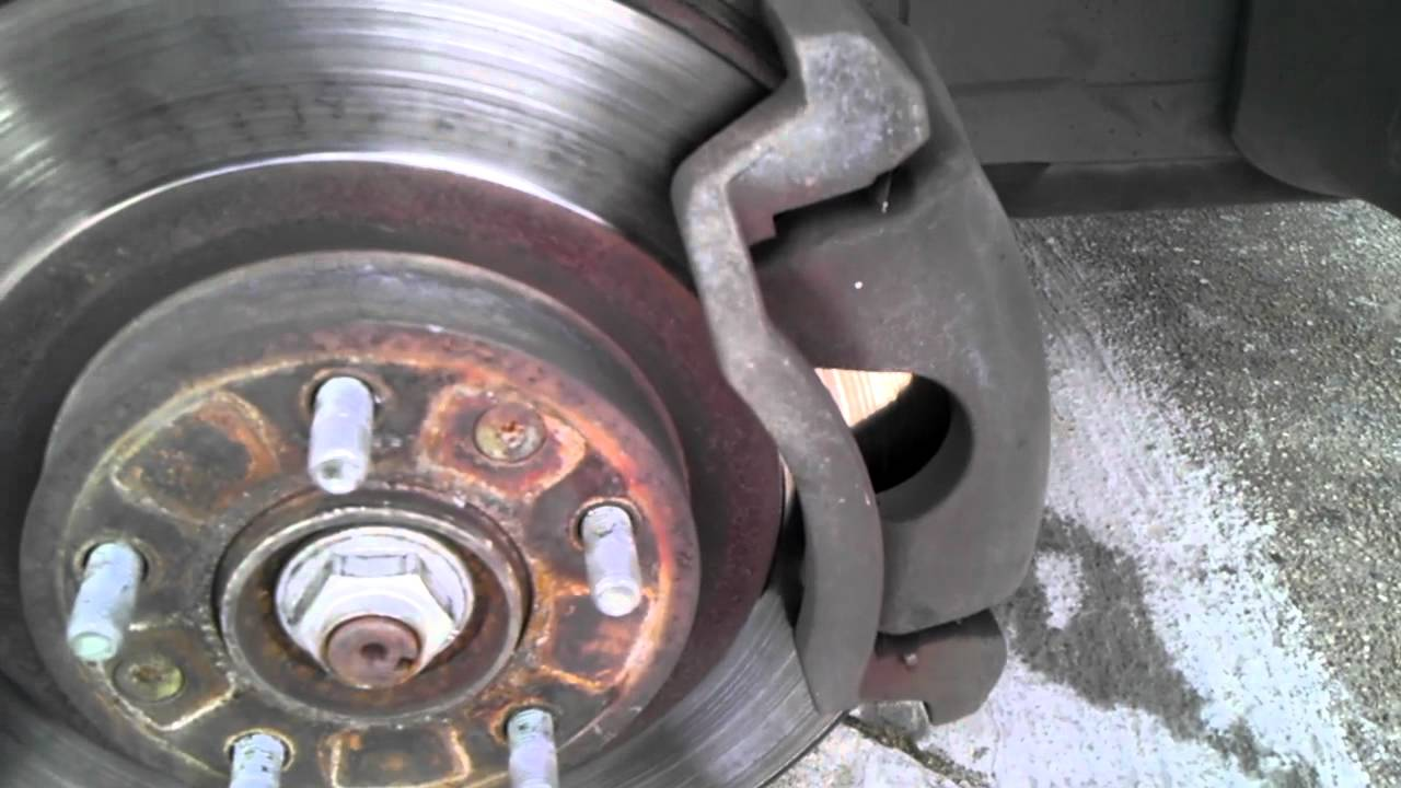 how to change rear brake discs and pads on ford focus