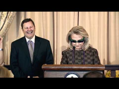 Raw Video: Clinton Dons Wild-Cat Eye Glasses