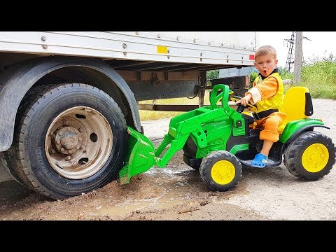 Truck stuck in the mud - Rubble ride on power wheels tractor to help