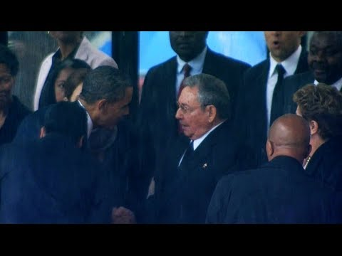 Video: Obama shakes hands with Raul Castro at Mandela's memorial
