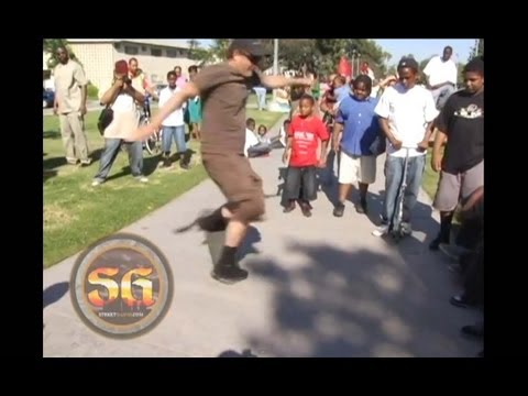 Stacy Peralta teaching skateboard tricks in the Jungles, South LA