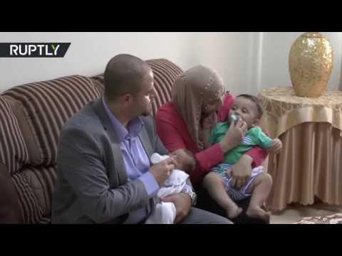 فلسطيني يطلق اسم بشار الأسد على مولوده الجديد