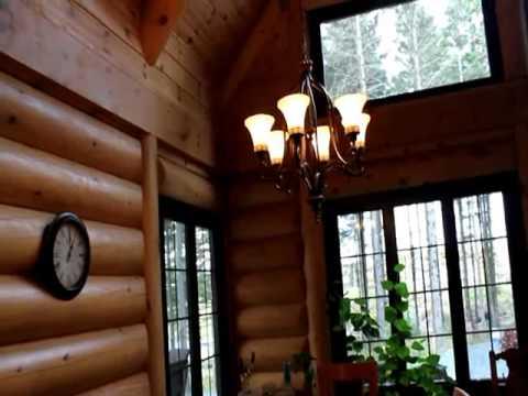Maison chalet en bois rond saguenay lac st jean youtube for Maison en bois ronde