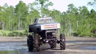 BAD ASS BIG TRUCKS IN THE MUD. MUDDING. ((( PART 1 OF 2