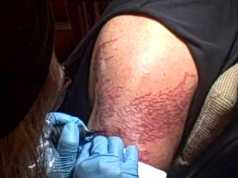 Brian Dougherty getting tattooed by  Tattoo Artist Jim Palmer at Moon Gravel Arts Studio 6/9/09
