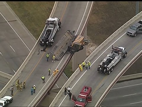 Construction vehicle dangles off Texas turnpike