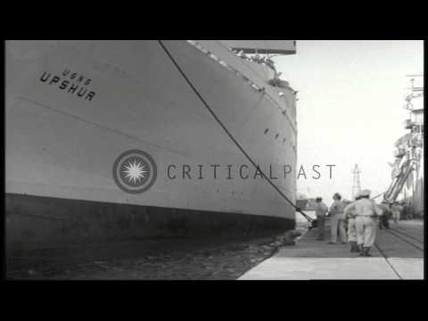 USS Upshur arrives at a pier in a port and US sailors watch the vessel in Beirut,...HD Stock Footage