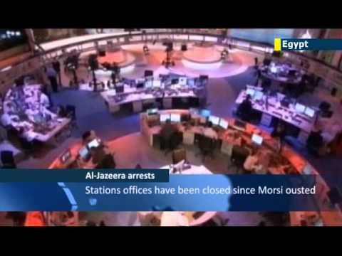Egypt TV shows Al-Jazeera journalists' arrest