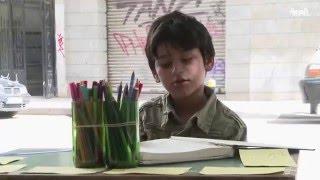 بالفيديو.. طفلان سوريان يرسمان في شوارع بيروت لكسب لقمة العيش |