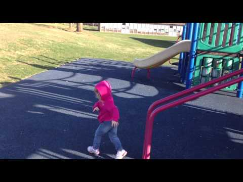 Ella Slides Down the Bars at the PlayGround