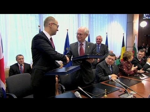 Ukraine signs political deal with EU