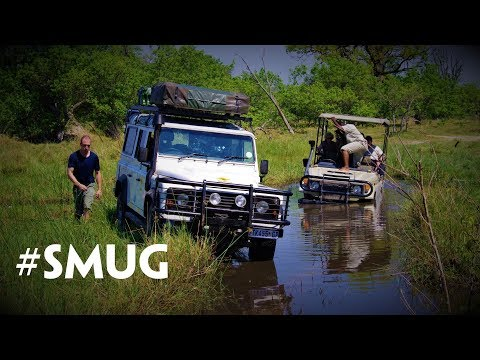 Rescuing a safari Toyota with a Land Rover in Botswana