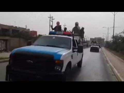 Iraq crisis: ISIS parade captured Iraqi military vehicles in Mosul