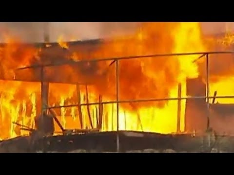 Australia wildfires: Thousands stranded in Tasmania - video news