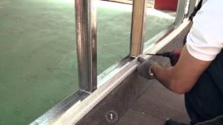 Construcción de muros de placa de cemento