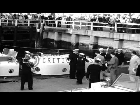 King Faisal II and his royal party boards a barge and the King walks up a ladder ...HD Stock Footage