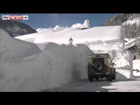 Snowfall Buries Italian Village - Freak Weather Places Europe On Red Alert