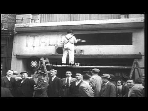 Civilians leave England as soldiers prepare to face the Nazis during World War II...HD Stock Footage