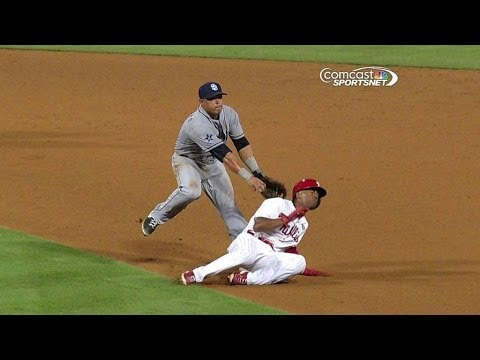 SD@PHI: Rollins avoids the tag and loads the bases