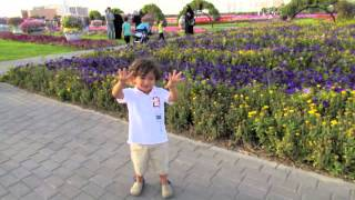 Young boy wandering Miracle Garden
