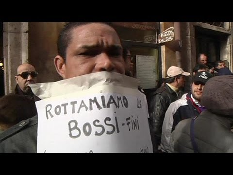 Demonstrators in Rome call for immigration law change.